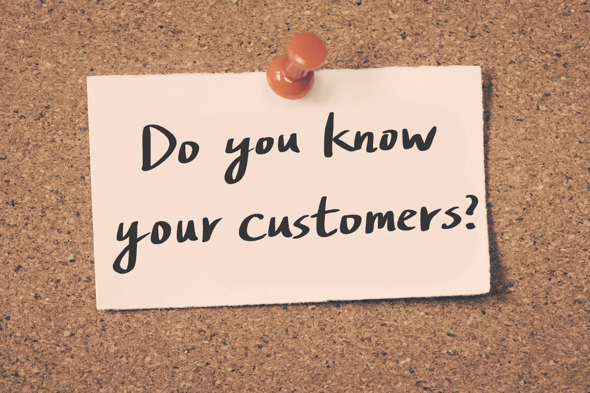A post-it note with 'Do you know your customers' written on it.